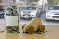 Money in the glass bottle with Car showroom background Stock Images
