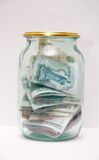 Money in the glass jar Royalty Free Stock Images