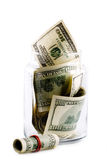 Money in glass jar. Isolated on whiter background Royalty Free Stock Photo