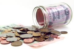Money in the glass jar Royalty Free Stock Image
