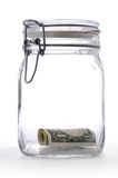 Money in a Glass Jar. One Dollar in a Glass Jar on a white background stock image