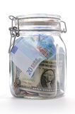 Money in a Glass Jar. On a white background royalty free stock photo