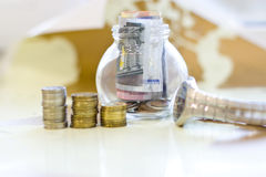 Money in a glass jar. Stock Images