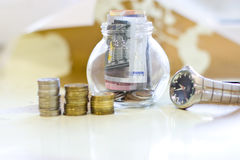 Money in a glass jar. Stock Photos
