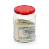 Money in a glass jar is isolated Stock Photo