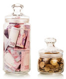 Money in glass jars Royalty Free Stock Photos