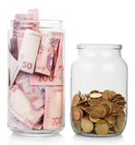 Money in glass jars Royalty Free Stock Photo