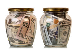 Money in glass jars Royalty Free Stock Photography
