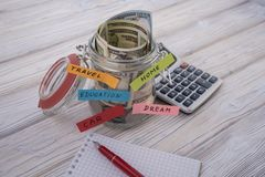 Money in the glass for travel, home, car, education, dream, save and retirement, save money concept with. Jar and money. business banking royalty free stock images