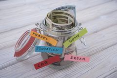 Money in the glass for travel, home, car, education, dream, save and retirement, save money concept with. Jar and money. business banking stock photo