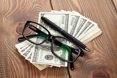 Money, glasses and pen Royalty Free Stock Photos