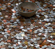 Money for god. A bowl for collecting money Stock Images