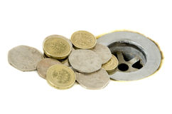 Money going down the drain. English money going down the drain cutout Royalty Free Stock Image