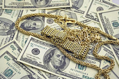 Money and gold. Us money and  yellow gold Royalty Free Stock Photography