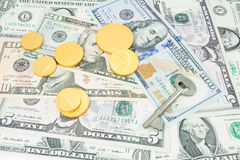 Money and gold coins Stock Photos