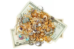 Money and gold jewelry Royalty Free Stock Photo