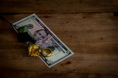 Money and gold on the old wooden floor.still life Stock Photography