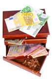 Money and gold in a wooden casket Stock Image