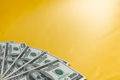 Money on a golden background stock photo