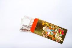 Money in Golden envelope. Money (Thai baht) in Golden&Red envelope on white background. Chinese new year reward. Bonus stock photography