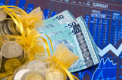 Money and golden pouch Royalty Free Stock Photo