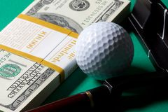 Money golf club and ball Stock Photo