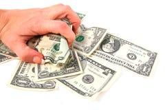 Money Grabber. Hand grabbing money royalty free stock photography