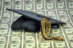 Money for graduation and cap with 2 dollar bills Stock Photos