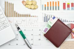Money and graphs Royalty Free Stock Images