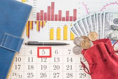 Money and graphs Stock Image