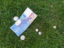 Money on the grass stock photography