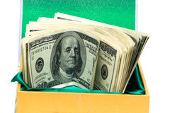 Money in green box Royalty Free Stock Photography