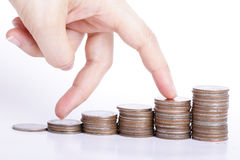 Money growing concept with finger go up on stack coin Royalty Free Stock Photo