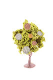 Money growing on tree. Small miniature trees growing silver gold and copper, coins in different currency like dollars, yen, euro, and the British pound Royalty Free Stock Photo