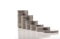 Money growth. Stack of coins isolated on white background Stock Photography