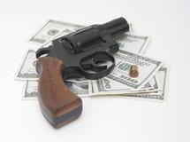 Money & gun Royalty Free Stock Image
