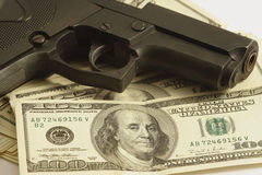Money and gun Royalty Free Stock Photo