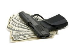 Money and a gun Stock Photography