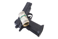 Money and a gun. Hundred-dollar bills with a gun on a white background Stock Images