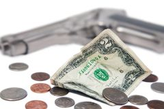 Money and a gun Stock Images