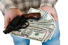 Money and gun. Young man with gun and money isolated on white Stock Photos