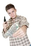 Money and gun. Young man with gun and money isolated on white focus on money Royalty Free Stock Photos