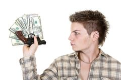 Money and gun. Young man with gun and money isolated on white Stock Image