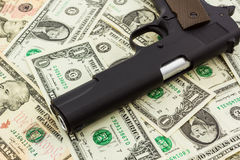 Money with Gun. Royalty Free Stock Photography
