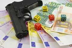 Money gun and dice Royalty Free Stock Photos