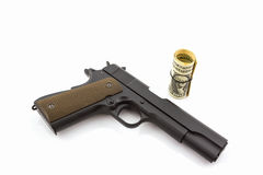 Money with gun. Stock Image