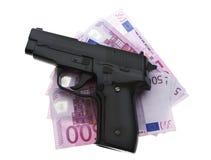 Money and guns Stock Photos