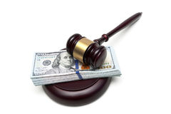Money and a hammer of the judge on a white background. Royalty Free Stock Images