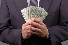 Money in Hand. Cash in hands by a businessman Royalty Free Stock Photography