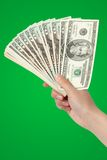 Money in hand. Isolated on green background Stock Photo